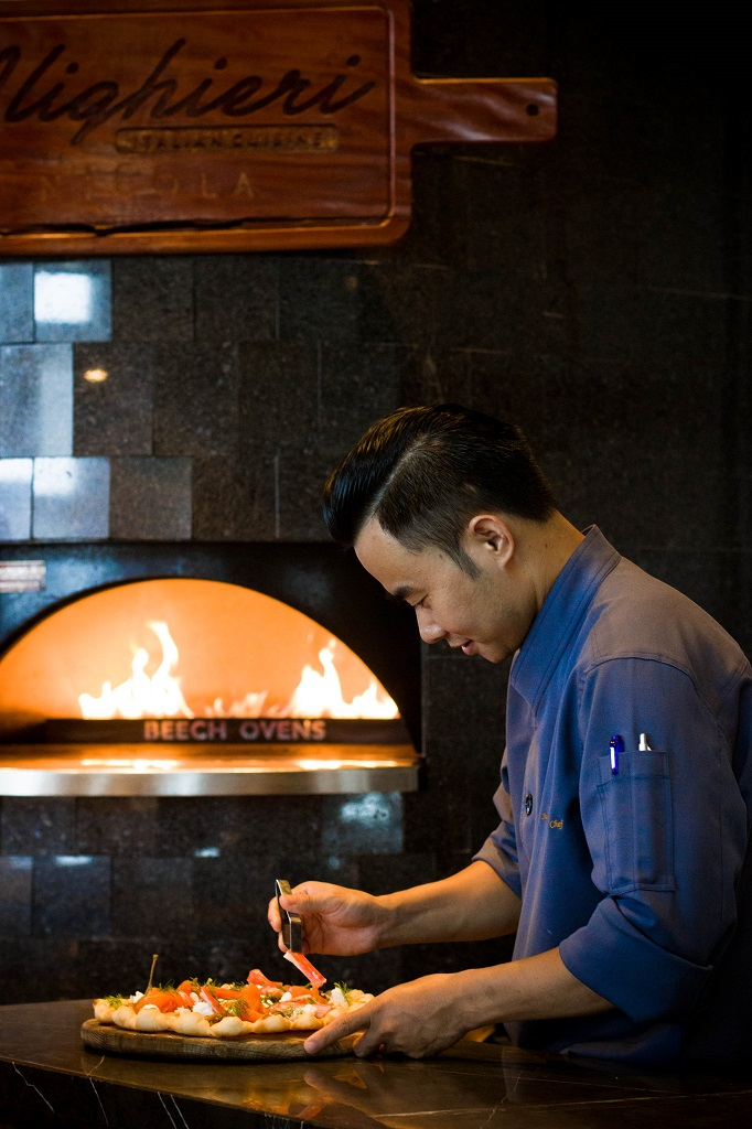 a chef preparing food at a restaurant in Hanoi