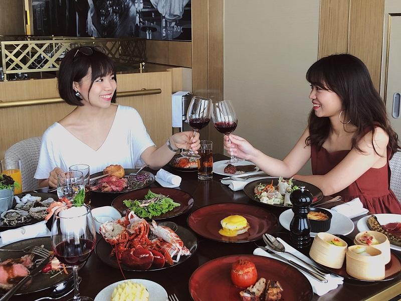 friends enjoying buffet lunch at a Hanoi hotel