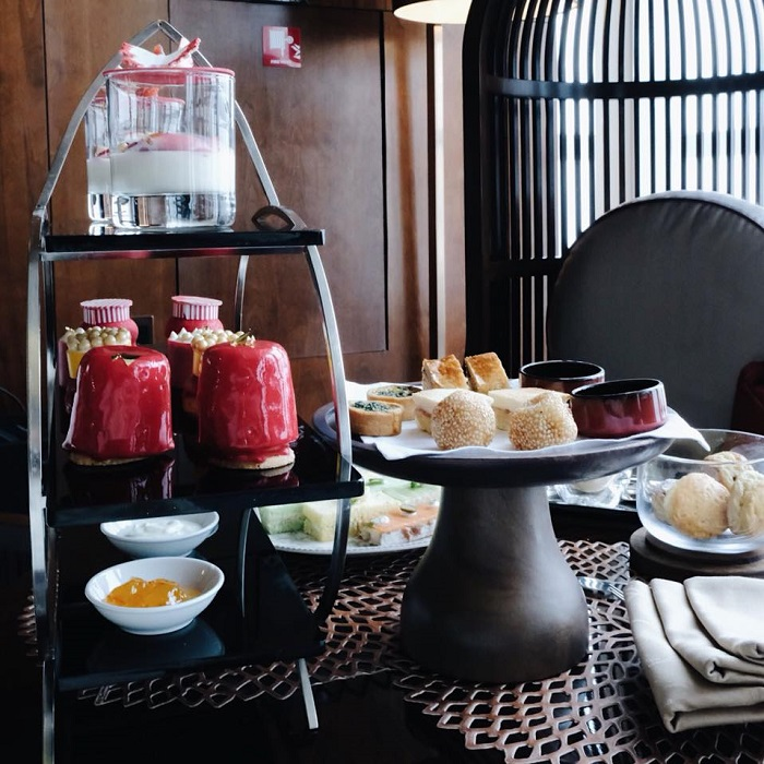 vibrant red theme afternoon tea at Hanoi hotel restaurant