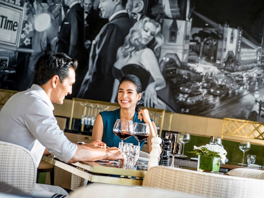 a couple enjoying wine at intercontinental hanoi landmark72 Hanoi hotel bar
