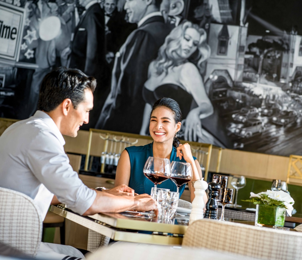 a couple dining and enjoying wine at Hanoi hotel restaurant