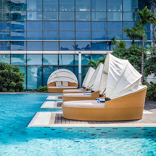 Hanoi hotel sunbeds by the swimming pool