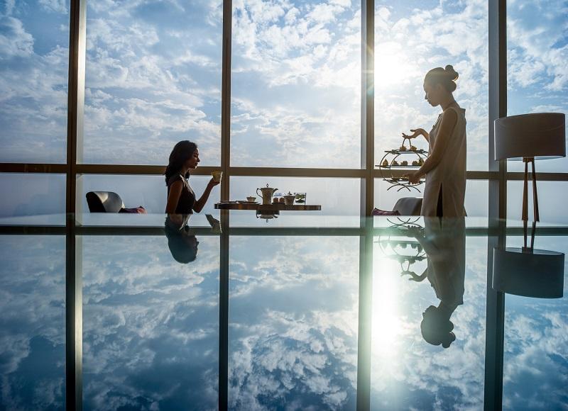 two girls enjoying afternoon tea at hanoi luxury hotel