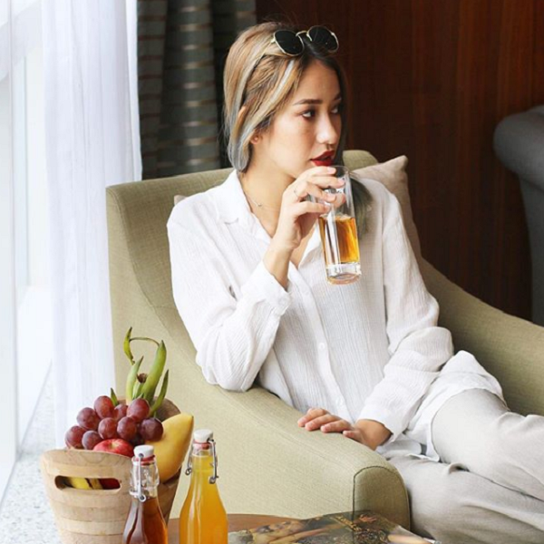 a woman relaxing in a luxury suite in intercontinental hanoi landmark72 hanoi city hotel
