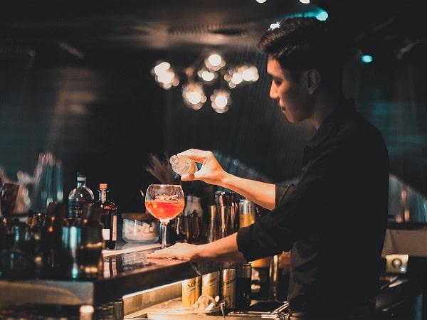 a bartender preparing cocktail at a Hanoi hotel bar