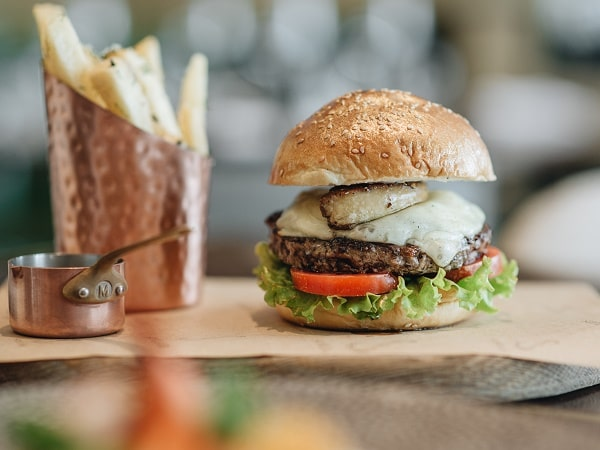 Hanoi hotel signature burger set with thick cut fries