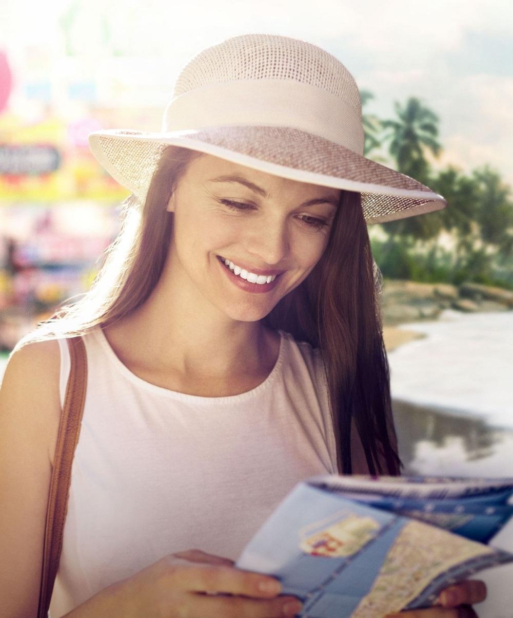 woman enjoying her vacation with hanoi city hotel