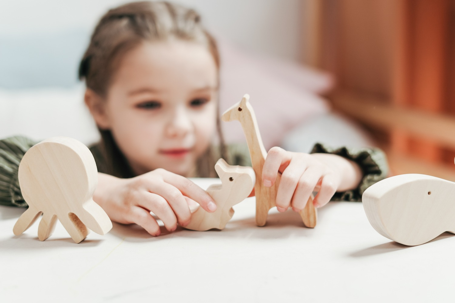 girl playing wooden kid toy