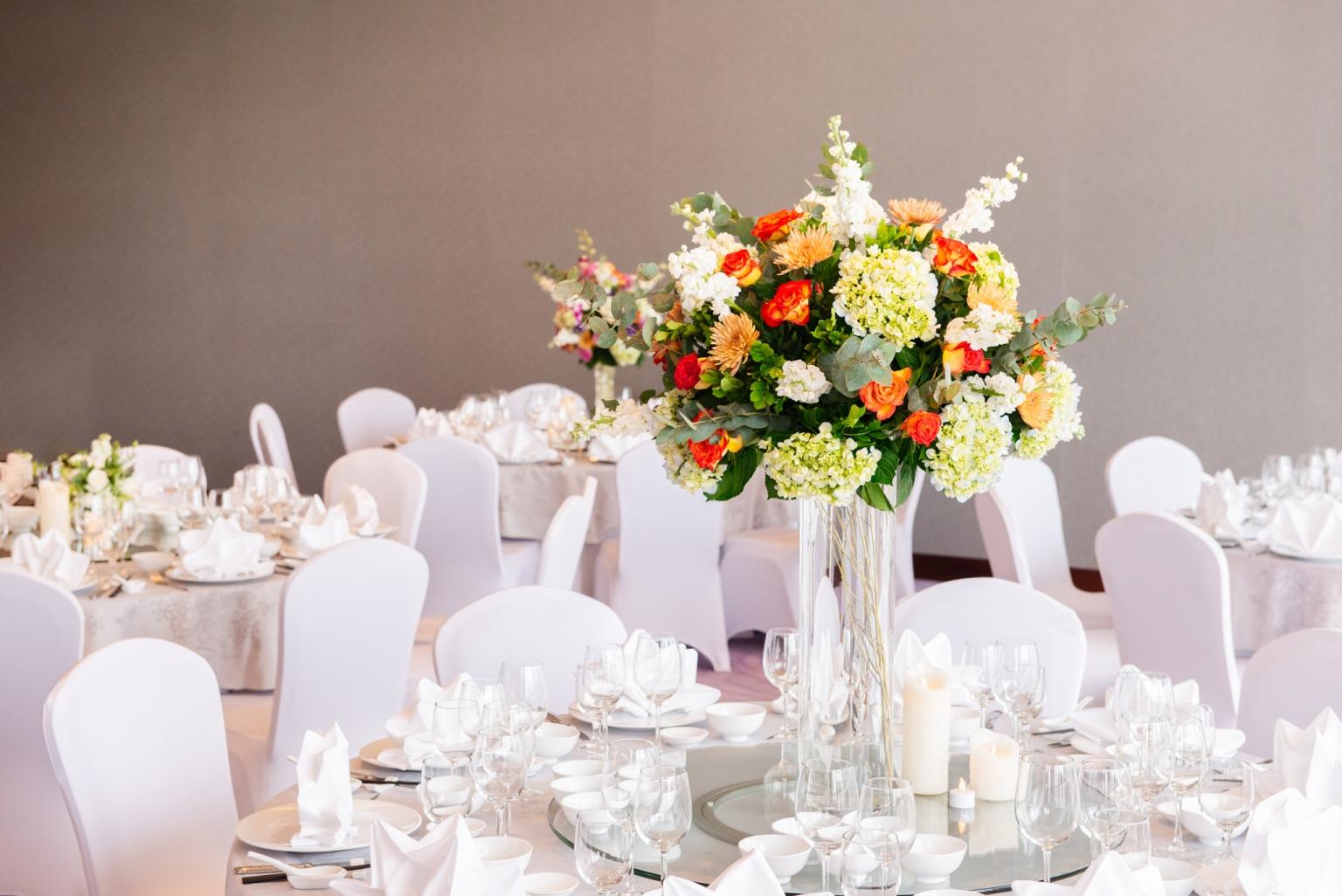 Hanoi hotel wedding table arrangment with orange flowers