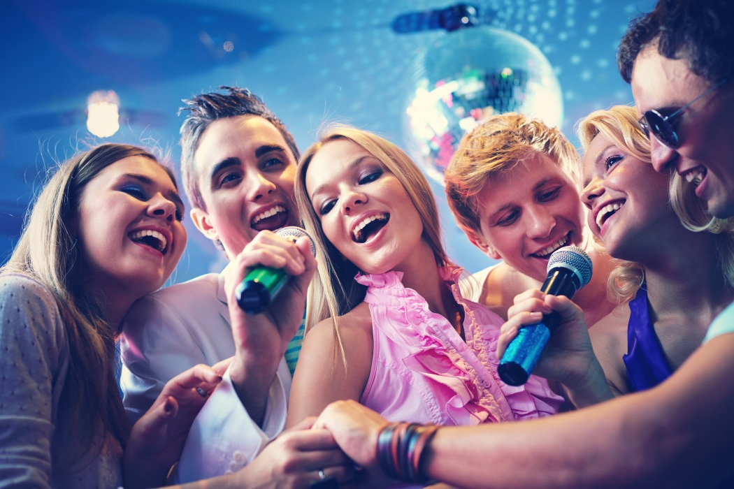 intercontinental hanoi happy colleagues singing karaoke together