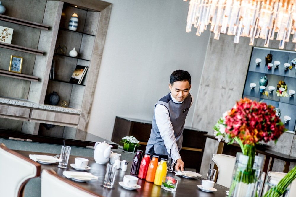 a Hanoi hotel staff is preparing the dining table