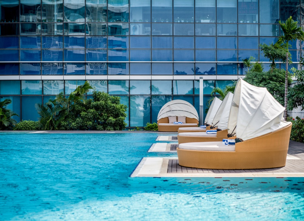 intercontinental hanoi outdoor swimming pool with sunset view