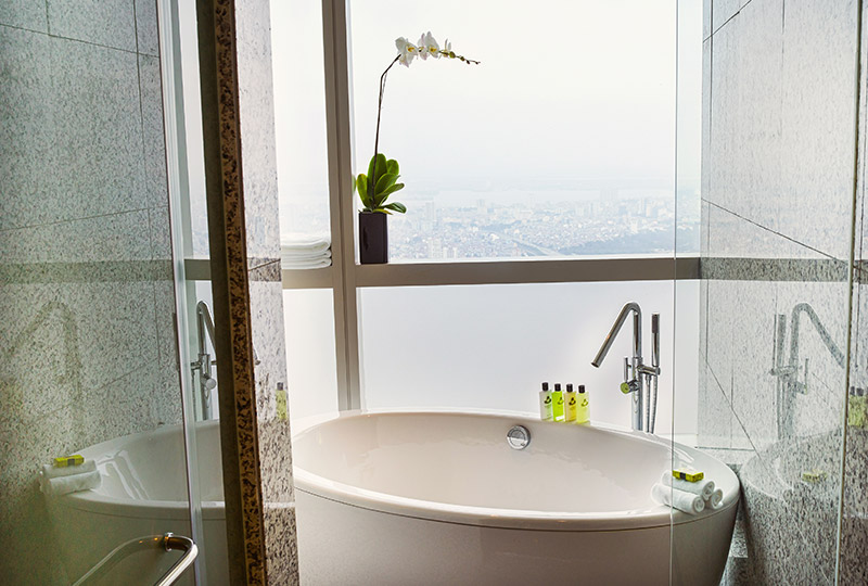 Hanoi luxury hotel bathtub with city view