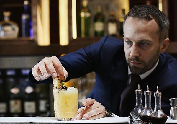 a bartender preparing cocktail at Hanoi bar