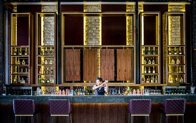 a bartender preparing cocktail at Hanoi hotel bar