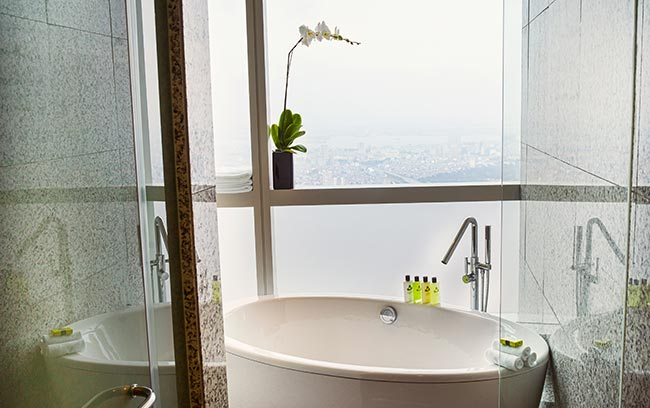 Hanoi luxury hotel bathroom with city view