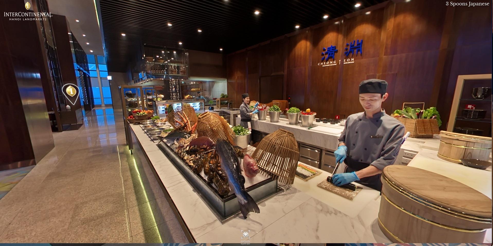 a chef preparing sushi at a Hanoi hotel open kitchen