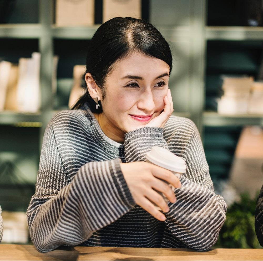 a lady enjoying a coffee in Hanoi luxury hotel