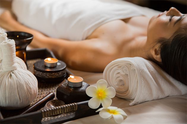 female guest enjoying a spa treatment at intercontinental hanoi landmark72 hanoi city hotel